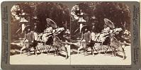 view (78) Girl feeding sacred deer on her way to prayers - grounds of Kasuga temple, Nara, Japan digital asset: (78) Girl feeding sacred deer on her way to prayers - grounds of Kasuga temple, Nara, Japan, [graphic]