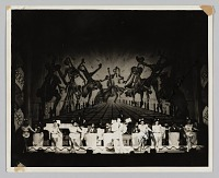 view Photograph of a performance with a band, dancers, and singer digital asset number 1