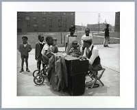 view Photographic print of children and pianist at Terrace Village housing project digital asset number 1