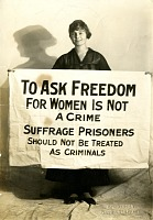 view Photograph: Suffragist with banner digital asset number 1