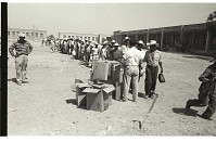 view Braceros Boarding Buses digital asset: At the Monterrey Processing Center, Mexico, braceros receive packed lunches as they board buses to the Hidalgo Processing Center, Texas, on the U.S.-Mexico border.