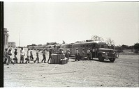 view Braceros Boarding Buses digital asset: At the Monterrey Processing Center, Mexico, braceros receive packed lunches as they board a line of buses to the Hidalgo Processing Center, Texas, on the U.S.-Mexico border.