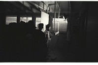 view Braceros Standing for Photographs digital asset: Two braceros stand for identification photographs at the Hidalgo Processing Center, Texas, while others wait in line.