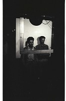 view Braceros Standing for Photographs digital asset: Two braceros stand for identification photographs at the Hidalgo Processing Center, Texas.