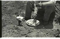 view Bracero at Meal Time digital asset: A bracero has lunch while sitting on the edge of a field in California.