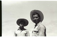 view Braceros in Field digital asset: Portrait of two braceros.