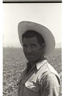 view Bracero in Field digital asset: Portrait of a bracero standing in a field in California.