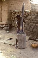 view child grinding millet crop Dogon region, Mali digital asset: child grinding millet crop Dogon region, Mali
