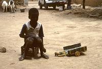 view Child with toy cart, Dogon region, Mali digital asset: Child with toy cart, Dogon region, Mali