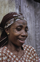 view Yoruba woman with facial tattoos digital asset: Yoruba woman with facial tattoos
