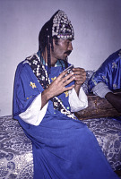 view Mukhtar Guinia or Hassan Arhaen, brother and friend of famous Gnawa musician, Mahmoud Guinia Essaouira, Morocco digital asset: Mukhtar Guinia or Hassan Arhaen, brother and friend of famous Gnawa musician, Mahmoud Guinia Essaouira, Morocco