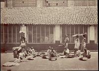view Sinhalese women cleaning and sorting coffee beans in baskets with Sri Lankan man carrying bag on shoulders nearby, undated digital asset number 1