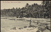 view Man with Two Boys in Costume, Surf Fishing Near Village Of Thatch Houses and Outrigger Canoes on Beach n.d digital asset number 1