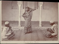 view Nautch girl dancing with two men playing string instrument and drum nearby 1862 digital asset number 1