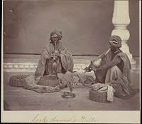 view Two snake charmers playing to cobras, undated digital asset number 1