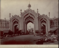 view Gateway Hussainnabad with group of East Indians by thatch shelters with food and goods nearby 1863 digital asset number 1