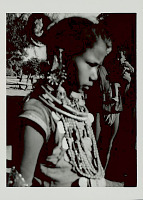 view Girl in Costume and with Ornaments; Man in Costume and With Infant Nearby 1965 digital asset number 1