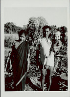 view Man, Woman, and Infant in Costume and with Ornaments in Field 1965 digital asset number 1