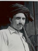 view Man Wearing Turban Near Wood Structure 1956 digital asset number 1