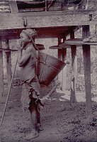 view Woman in Costume, Carrying Burden Basket with Tumpline and With Bamboo Walking Stick Outside Platform House 1908 digital asset number 1