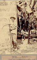 view Young Man in Costume with Cross Bow Near Masonry Wall 1901 digital asset number 1