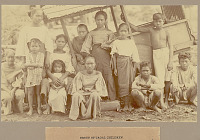 view Group of Children Near Thatch-Covered Wagon with Wood Wheels 1901 digital asset number 1