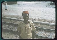 view Tanganyika portrait: red fez and hanging earlobes, circa 1956 digital asset number 1