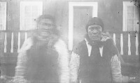 view Two Men in Native Dress Outside Wood Frame House 1877 digital asset number 1
