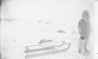 view Man in Native Dress Pulling Sled 1877 digital asset number 1