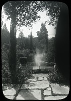 view Unidentified Garden in Pasadena, California: a water jet sprays water by a pool. digital asset: Unidentified Garden in Pasadena, California: a water jet sprays water by a pool.: [between 1914 and 1949?]