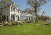 view [Baylis Garden]: white brick house to left, lawn, and shore line to the right. digital asset: [Baylis Garden]: white brick house to left, lawn, and shore line to the right.: 2005.