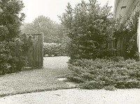 view [Unidentified Garden(s) in New Canaan, Connecticut]: view through fence. digital asset: [Unidentified Garden(s) in New Canaan, Connecticut] [photoprint]: view through fence.