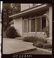 view [Unidentified Garden in New Canaan, Connecticut]: doorway from patio into house, showing foundation planting. digital asset: [Unidentified Garden in New Canaan, Connecticut] [photoprint]: doorway from patio into house, showing foundation planting.