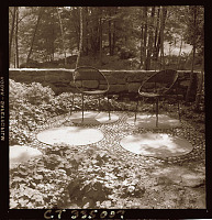 view [Unidentified Garden in Connecticut, No. 1]: stone patio, showing use of circular concrete pavers. digital asset: [Unidentified Garden in Connecticut, No. 1] [photoprint]: stone patio, showing use of circular concrete pavers.