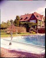 view [Unidentified Garden in Massachusetts, No. 2]: swimming pool and mansion. digital asset: [Unidentified Garden in Massachusetts, No. 2] [photoprint]: swimming pool and mansion.
