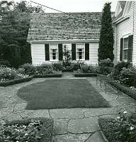 view Unidentified Garden in Massachusetts, No. 4: box-hedged garden borders adjacent to house. digital asset: Unidentified Garden in Massachusetts, No. 4 [photoprint]: box-hedged garden borders adjacent to house.