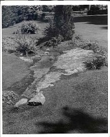 view [Rockledge]: rock outcropping in foreground with wall in background. digital asset: [Rockledge] [photoprint]: rock outcropping in foreground with wall in background.