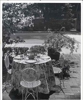 view [Garden Oasis]: eating area by the swimming pool. digital asset: [Garden Oasis] [photoprint]: eating area by the swimming pool.