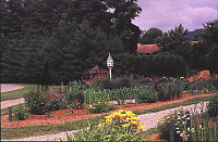 view [Crowfields Community Gardens]: view from southwest with birdhouse and gazebo in the background. digital asset: [Crowfields Community Gardens]: view from southwest with birdhouse and gazebo in the background.: 2000 Jul.