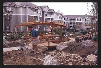 view [Post Green Hills]: landscape architect painting bedlines on the ground with a spray gun during initial installation. digital asset: [Post Green Hills]: landscape architect painting bedlines on the ground with a spray gun during initial installation.: 1996.