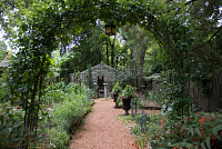 view [The Craighead House and Garden]: pear trees are trained to the arch over the entrance to the vegetable garden. digital asset: [The Craighead House and Garden]: pear trees are trained to the arch over the entrance to the vegetable garden.: 2013 Aug.