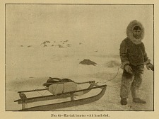 Kaviak hunter with hand sled.