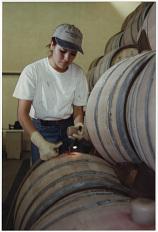Gloria Ceballos topping off barrels, 1997