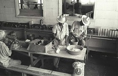 Braceros making tortillas, 1957