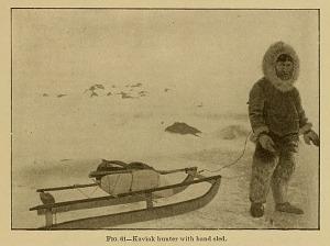 Kaviak hunter with hand sled.
