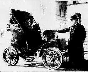 West Virginia Senator and Mrs. Nathan B. Scott with their automobile in front of the U.S. Capitol, about 1905