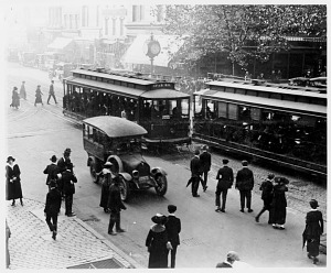 Passengers wait to board streetcars at 11th and F Streets, N.W., Washington, ca. 1915