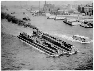 Tugboat moving flats of railroad freight cars, about 1915
