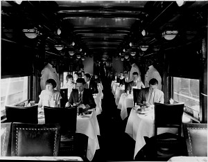 Dining car interior, with waiters attending, 1925