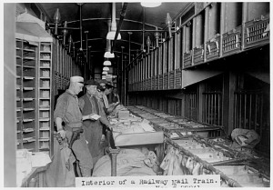 Postal Department clerks sort mail aboard a Railway Post Office (RPO) car, literally a U.S. post office on wheels.